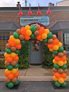 Corporate event; balloon decorator; balloon arch in fall colors
