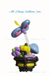 balloon artist: balloon basket with balloon flowers; mushroom; butterfly