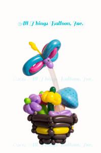 balloon artist: balloon basket with balloon flowers; mushroom; butterfly