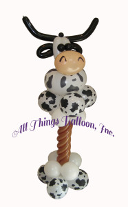balloon decor: Cow themed balloon column