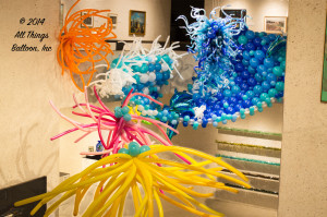 Balloon Decor - ocean wave sculpture with balloon Dolphins