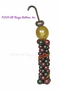 balloon decor: balloon column with Christmas ornament on top