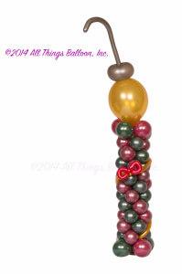 balloon decor: balloon column with Christmas ornament on top