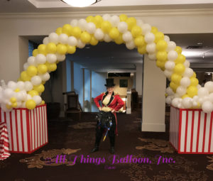 balloon decorator - balloon arch; popcorn theme