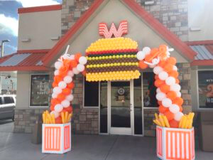 What A Burger Grand Opening arch with Balloon Fries and Balloon Burger